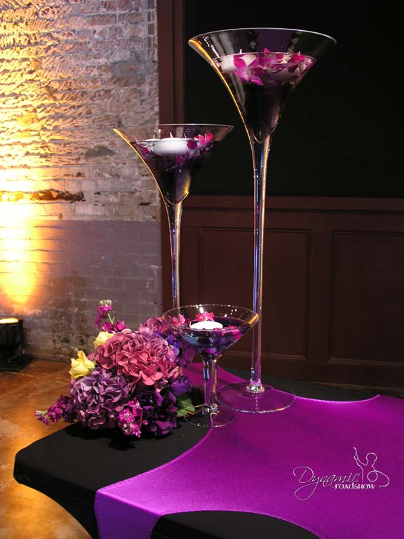 Dynamic Martini Vases with Coloured water and candles piece from £25 each